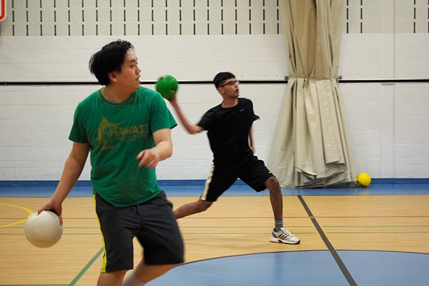 two people throwing dodgeballs