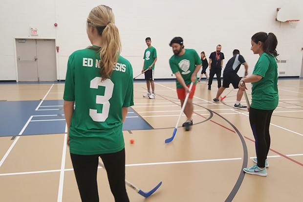 AppCentrica's team playing floor hockey