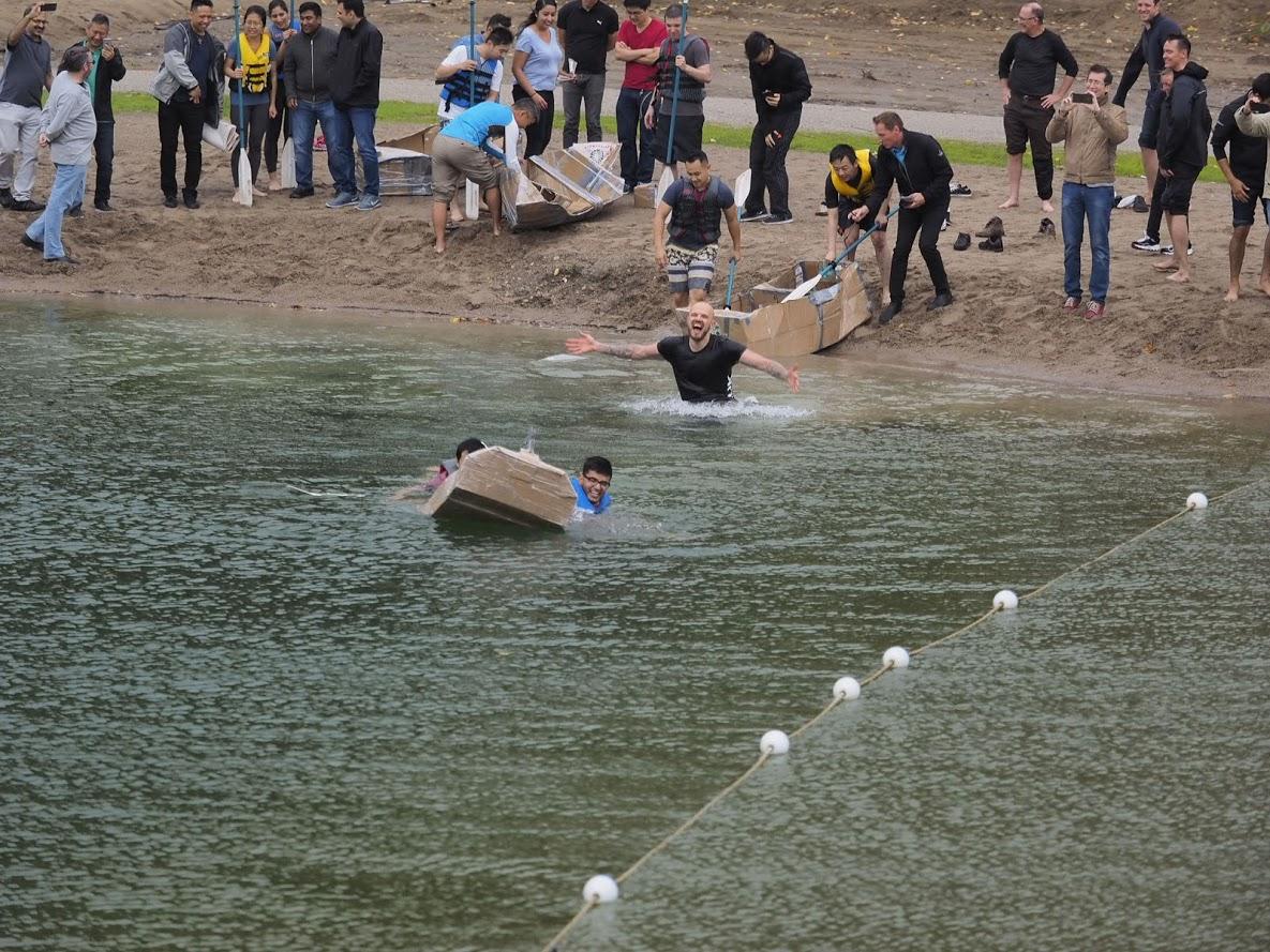 A cardboard boat taking on water